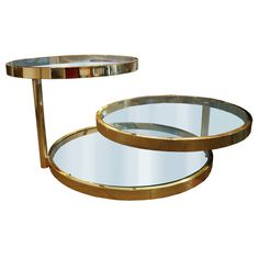 Design Institute of America Brass Swivel Table | From a unique collection of antique and modern coffee and cocktail tables at https://www.1stdibs.com/furniture/tables/coffee-tables-cocktail-tables/