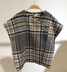 A very cool plaid poncho form the winter collection of Chloe kidswear