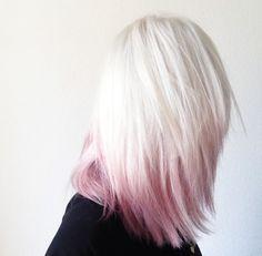 Platinum blonde hair with pastel pink dip dye