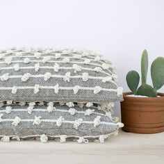 "La Niebla Floor Pillow, cotton insert included, 28""sq, 100% sheep's wool, dove grey and cream, $225"