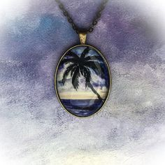 I updated this pendant to show more of the palm tree and the colorful tropical sunset from my original painting.