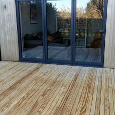 Seamless Accoya decking with hidden fixings and cladding.