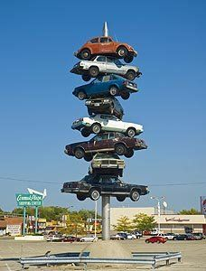 Now I (perhaps) understand the meaning of this. Historic Rt 66 begins (or ends) in Chicago The Spindle, consisted of 8 cars impaled on a spike, was a sculpture created in 1989 by Dustin Shuler. It was located in Berwyn, Illinois at Cermak Plaza. Route 66 Attractions, Old Route 66, Route 66 Road Trip, Historic Route 66, Travel Route, Us Travel, The Places Youll Go, Places To Go, Places
