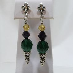 Check out this item in my Etsy shop https://www.etsy.com/listing/121073316/fleur-de-lis-mardi-gras-cone-earrings