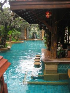 Pool bar in a tropical paradise lined by abstract vegetation and defined by beau. Pool bar in a tropical paradise lined by abstract vegetation and d. Outdoor Pool, Outdoor Spaces, Outdoor Living, Pool Backyard, Pool Landscaping, Pool Decks, Courtyard Pool, Outdoor Bars, Backyard Kitchen
