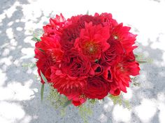 """Hearts"" roses, red tulips, red dahlias and seeded eucalyptus Designed by: hillside-consultants.com"