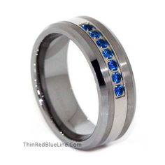 Thin Blue Line Brushed Tungsten Carbide Ring 7 Blue CZ Diamonds 8MM. 10% of donations go to police and firefighters. I would love this with real sapphires :)