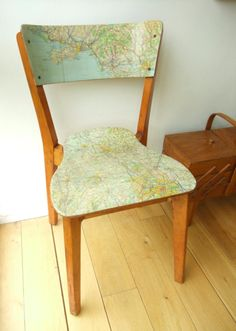 instead of painting an old chair or table, use maps and varnish