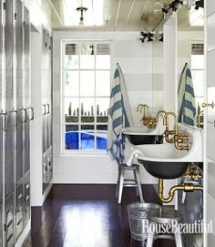 Nautical Bathroom.  Amazing Steampunk Lights.  Lockers.  Grey White Stripes.  Brass Faucets, Fixtures.  Cast Iron Trough Sink...loving the lockers and striped paint