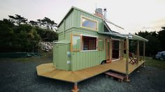 This is a custom solar-powered tiny house on wheels with a built-in deck designed and built by Jeff Hobbs, a boat builder and cabinet maker, for his client in New Zealand. From the outside, you&#82…