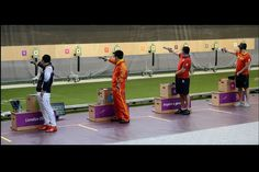 Final of the 10m air pistol for men, Jongoh Jin, far left, from Korea, on his way to winning gold. Photo: Pat Scala