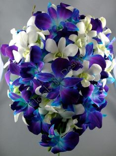 grey and blue wedding decor | ... T45 Bridal bouquet of white and blue Singapore Orchids