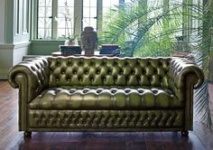 Vintage green Chesterfield leather tufted sofa adds an attractive pop of color and sophistication to a minimalist space.