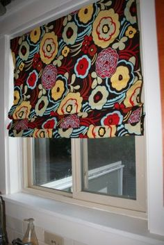 DIY window covers that work like blinds! would be cute in laundry room