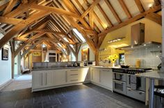 Beautiful barn conversion in Devon, England designed by architect Roderick James Carpenter Oak. Barn Conversion Interiors, Home Renovation Loan, Barn Kitchen, Nice Kitchen, Oak Frame House, Converted Barn, Shed Homes, Barn Homes, Luxury Homes Interior