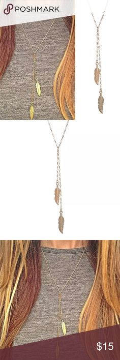 Gold Feather Double Lariat Gold feather Lariat, gorgeous gold chain with detailed feathers on both ends- both feathers pull through to adjust to any length! Super cute Lariat necklace! NWT Jewelry Necklaces