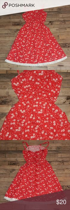 Super cute vintage 80's 90's day dress! Darling little day dress! Red floral pattern with crochet ruffle hem. Buttons up the back and straps button as well. Awesome front pockets and criss cross tie to cinch waist. Measurements are-  Bust-32 Waist-28 Hips-40  Will have pics with model soon! Vintage Dresses Midi