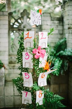 seating chart displayed on a postcard display, photo by Best Photography http://ruffledblog.com/florida-spring-wedding-ideas #weddingideas #seatingchart