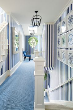 """""""The cobalt striped walls are designed to connect the whole house, from the basement stairwell all the way up to the tower,"""" says Sikes."""