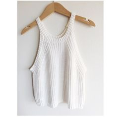 Charlotte Russe Knitted Top Lightly worn. Pair with light denim shorts or make it an all white ensemble! Top falls right below belly button for me. Charlotte Russe Tops Tank Tops