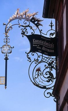 Shopsign of Schlosserei und Kunstschmiede (Locksmithery and Artist blacksmithery) Bruno & Frank Herrmann seit 1893 (since Maikammer, district Südliche Weinstraße (southern wine route), Rhineland-Palatinate, Germany. Storefront Signs, Pub Signs, Shop Fronts, Signage Design, Business Signs, Store Signs, Objet D'art, Hanging Signs, Vintage Signs