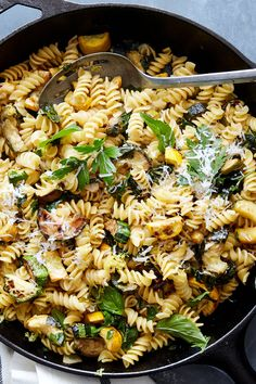 NYT Cooking: This simple pasta comes together quickly and makes use of what can sometimes be an overwhelming bumper crop of zucchini and other summer squash come August. Browning the squash in two batches is the only semi-fussy request, and it pays off by Herb Recipes, Pasta Recipes, Cooking Recipes, Raw Recipes, Zucchini Pasta, Pasta With Zucchini And Mushrooms, Cooking Zucchini, Zucchini Parmesan, Squash Pasta
