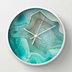 You need to find a place for this turquoise marble wall clock on your wall.