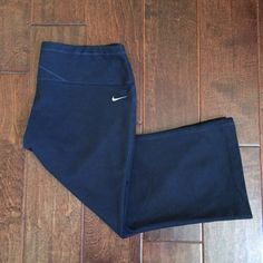 Nike Fit Dry Sports Capri Nike Sports Capri Fit Dry  Color: Black | Navy Dark Blue  In good condition | A bit dirty | As you can see in the photo grid on the back the stitching is loose but it's fine Material: 65% Cotton | 26% Polyester | 9% Spandex  Measurements: Inseam is 20 inches | Waist is  15 inches from Left to Right  Open to Offers & Ask me to lower the price for discounted shipping  ❌No Trades❌ Nike Pants Capris