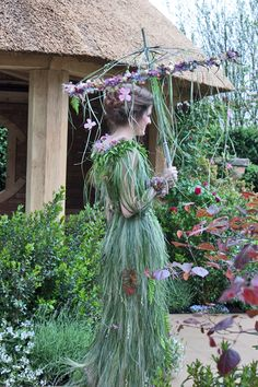 Bear grass and a selection of flowers, including clematis, hellebores, rose buds, pansies and astrantia were used to create the parasol.