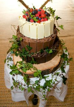 Chocolate cake decorated with forest berries, leaves etc. Hopefully by Kikki&Sweets.