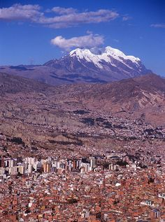 Bolivia's capital city of LaPaz with Illimani looming in the distance. The city is at 11,000-12,000' and Illimani is 21,125' and over 50 miles away.