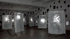 Christian Boltansky, Reflexion, 2000 — 400 black mirrors, 9 wheeled racks with suspended transparencies on cloth sheets. Each rack: 83 x 52 x 20 in. ( 210.8 x 132.1 x 50.8 cm )