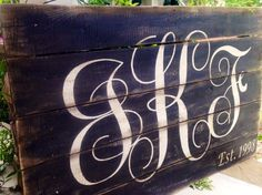 Personalized Monogram with established date on reclaimed pallet wood board. Size: Item measures 36 x 24 Colors: Board is black Lettering is