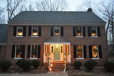 How to hang wreaths from upstairs windows without an electric company truck and other outside decorating tips from Young House Love. Christmas Wreaths For Windows, Christmas Decorations For The Home, Window Wreaths, Christmas Door, Simple Christmas, Merry Christmas, Pumpkin Decorating, Holiday Decorating, Decorating Ideas