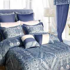 Bring some elegance and opulent style to your bedroom with this luxurious bed in a bag with sheet set. Sporting vivid blue and white accents, this bedding set includes a generous flat sheet, two pillowcases, and two decorative pillows.