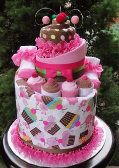 Cupcake Themed Diaper Cake www.facebook.com/DiaperCakesbyDiana
