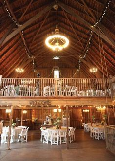 Beautiful rustic decorated barn - perfect for a ranch wedding reception. Photo by Aaron Snow Photography. #wedding #barn #rustic