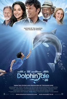 Dolphin Tale movie poster with cast above and Sawyer swimming toward Winter the dolphin