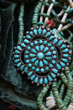 1930's turquoise cluster pin. We don't know what a 'cluster pin' is exactly, but now we want one!