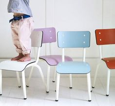 A colourful collection of kids chairs for a playroom creates a cool schoolroom vibe.