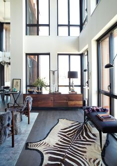 Love the double height ceilings and windows, not such a fan of the rug