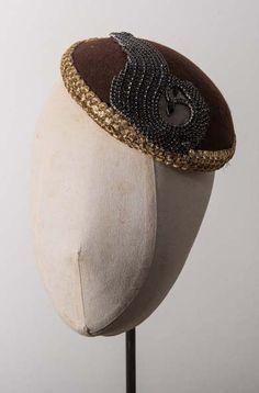 Be a golden girl in our Brown Felt Smartie Hat with Diamanté Deco Motif. £185.00.