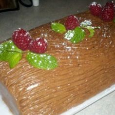 Chocolate Christmas Yule Log: Chocolate Christmas yule Log with fresh raspberries and mint on top for decoration. A fun and easy treat for the festive season. Christmas Appetizers, Holiday Desserts, Holiday Cookies, Holiday Baking, Christmas Baking, Holiday Recipes, Christmas Recipes, Holiday Ideas, Christmas Yule Log