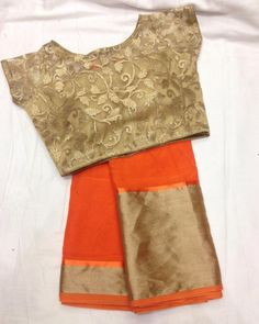 """Bright and bold orange saree with gold blouse To purchase mail us at… Sari Blouse Designs, Blouse Patterns, Saree Jackets, Gold Blouse, Saree Blouse, Orange Saree, Plain Saree, Simple Sarees, Blouse Models"
