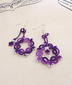 Delicate and elegant lace earrings in vibrant purple irish shades, hand-crafted in Waterford, Ireland. These beautiful earrings are made in two Lace Earrings, Lace Jewelry, Crochet Earrings, Jewellery, Unique Jewelry, Elderberry Jam, Waterford Ireland, Cotton Thread, Czech Glass Beads