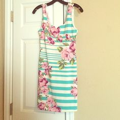 Flower pattern summer dress Super chic flower dress. Brand is Easel, bought at a local boutique. Teal lines and pink flowers. Never been worn. Dresses
