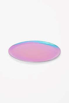 Designed to serve up food and drinks, this tray is made from stainless steel in a soft round shape.