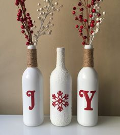Decorate your home with some Joy! These wine bottles are spray painted white and the letters are made with adhesive vinyl. The tops of the