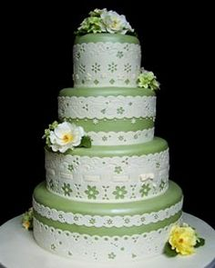 Four tier green and white lace wedding cake