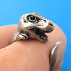 - Details - Sizing - Shipping A realistic T-Rex dinosaur animal ring that wraps…